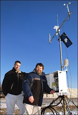 Daryl Herzmann and Raymond Arritt at a weather collection site