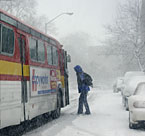 Passenger gets on bus during blizzard