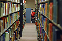 Student studies in library carrel.