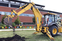 Groundbreaking with a backhoe